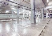 stock photo of parking lot  - empty car parking lot in modern building design with conveniance service - JPG