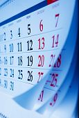 pic of oblique  - Month on a calendar viewd at an oblique angle with selective focus to the dates and numbers for the Friday  - JPG