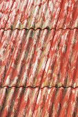 stock photo of asbestos  - Red painted corrugated asbestos cement roof background - JPG