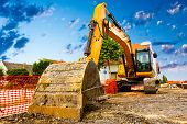 pic of power-shovel  - Excavator on new construction site in the background the blue sky - JPG