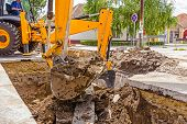 image of power-shovel  - Excavator on new construction site in the background the blue sky - JPG
