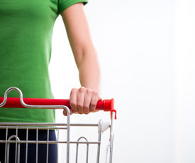 stock photo of grocery cart  - Young woman with shopping cart at supermarket hands close - JPG