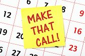 foto of take responsibility  - The phrase Make That Call written on a yellow sticky note and on a wall calendar - JPG