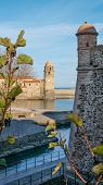 stock photo of chateau  - The Church of the Angels across the harbour from the Chateau Royal, Collioure, France ** Note: Visible grain at 100%, best at smaller sizes - JPG