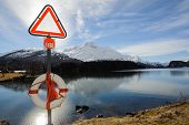 stock photo of ban  - lifebuoy and signboard the ban in front of an alpine lake - JPG