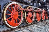 stock photo of train-wheel  - Old steam locomotive engine wheel and rods details
