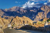 picture of jammu kashmir  - Highway of Leh with rocky mountains and snow peak with blue sky in background Leh Ladakh Jammu and Kashmir India - JPG