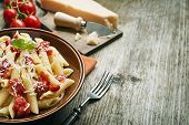 picture of pasta  - Plate of penne pasta with tomato sauce and parmesan cheese - JPG