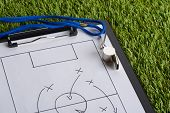 stock photo of clipboard  - Whistle And Clipboard With Soccer Tactic Diagram On Green Pitch - JPG