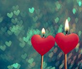 Постер, плакат: Red Hearts Candles On Vintage Hearts Bokeh As Background