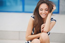 picture of slim model  - Summer portrait of a beautiful young brunette woman with long straight hair - JPG