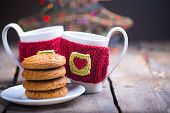 stock photo of knitting  - Knitted woolen cups on a wooden table - JPG
