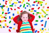 stock photo of little young child children girl toddler  - Child playing with colorful wooden toys - JPG