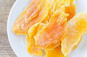 pic of mango  - Piece of Dehydrated mango on white ceramic dish - JPG