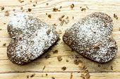 foto of chocolate fudge  - Two chocolate heart cookies in powdered sugar and chocolate crumbs - JPG