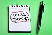 foto of job well done  - Well Done word closeup on notebook page - JPG