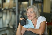stock photo of old lady  - Portrait of old lady exercising with dumbbell - JPG