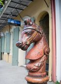 image of horse head  - This cast iron hitching post is a bridled horse head - JPG