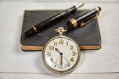 picture of fountains  - Antique fountain pen old calendar and watch on a white wooden table - JPG