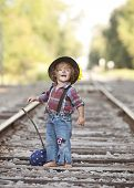 foto of hobo  - Adorable toddler on the railroad tracks dressed as a little hobo. ** Note: Visible grain at 100%, best at smaller sizes - JPG