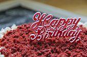stock photo of red velvet cake  - the happy bithday words at the top of red velvet cake - JPG