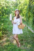 image of milkmaid  - young Woman Has Picnic In Summer Park - JPG