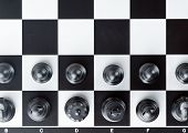 picture of chess pieces  - Chess board with chess pieces closeup background - JPG