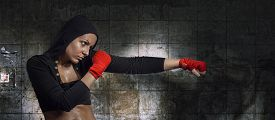 stock photo of hoodie  - Hard sport woman ready for fight - JPG