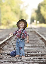 pic of hobo  - Adorable toddler on the railroad tracks dressed as a little hobo. ** Note: Visible grain at 100%, best at smaller sizes - JPG