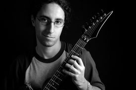image of ibanez  - portrait of boy and his guitar isolated over black - JPG