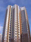 foto of row houses  - new flats building under blue sky highrise - JPG