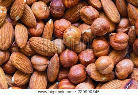 poster of Nuts Pile Background. Cashew, Almond, Hazelnut Mix Closeup. Organic Food Rustic Banner Template. Tas