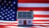 Solar Power Roof concept. Solar Panels on a house with an American flag. Solar Independence in the U poster