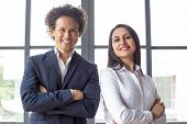 Happy Confident Multiethnic Entrepreneurs Looking At Camera And Standing In Office. Cheerful Success poster