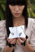 stock photo of chatterbox  - folded paper word game known as chatterbox cootie catcher fortune teller salt cellar or whirlybird - JPG
