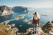 Tourist Woman Standing On Cliff Of Reinebringen Mountain Aerial View In Lofoten Islands Of Norway Tr poster