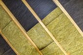 Thermal Insulation Mineral Rock Wool Installation At The New Building Attic Ceiling poster