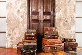 The Door And The Bag. Vintage Used Travel Suitcases. Many Old Vintage Suitcase. Luggage Concept. poster