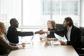 Satisfied Multiracial Businessmen In Suits Shaking Hands At Executive Team Office Meeting, Two Diver poster