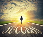 Man Walks On A Big Success Way. Concept Of Successful Businessman And Company Startup poster