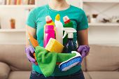 Young Woman Holding Bucket With Group Of Cleaning Supplies For Natural And Environmentally Friendly  poster