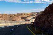Asphalt Road In Desert Negev, Israel, Road 40, Transport Infrastructure In Desert, Scenic Mountains  poster