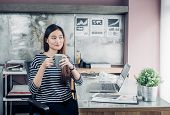 Asian Businesswoman Take A Coffee Break After Working With Smiling Face,happy Office Life Concept,wo poster