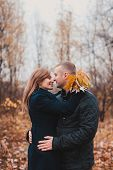 Affectionate Cozy Hugs Of Young Loving Couple In The Autumn Park poster