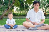 Father With Eyes Closed And Cute Little Asian 18 Months / 1 Year Old Toddler Baby Boy Child Practice poster