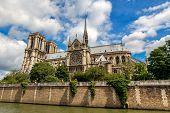 View of famous Notre-Dame de Paris Cathedral under beautiful sky in Paris, France. poster