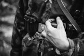 Re-enactor Dressed As World War Ii German Wehrmacht Soldier Holds His Hands On A Cartridge Belt. Det poster