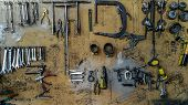 Keys In The Garage Tools. Old Tools Hanging On Wall In Workshop , Tool Shelf Against A Wall In The G poster