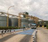 Modern Elevator For Storing Grain Against The Sky. Grain Drying Complex, Storage And Transportation  poster