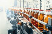 Conveyor Belt, Juice In Glass Bottles On Beverage Plant Or Factory Interior, Industrial Manufacturin poster
